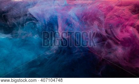 Ink In Water. Colorful Background. Contrast Fume Cloud. Soft Steam Texture. Glowing Neon Blue Magent