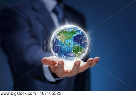 Businessman Hold Global World. Earth In Hand Of Business Man Show Usa World Map For Communicate, Env