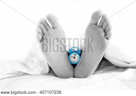 . The Legs Of The Deceased With A Clock Hanging On Them. Time Of Death. Morgue. Human Life Brevity C