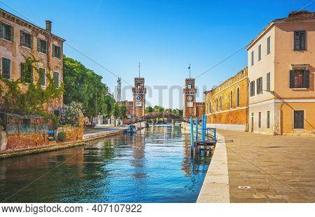 Venice Cityscape, Water Canal, Bridge And Gate Of Medieval Venetian Arsenal Or Arsenale Di Venezia.