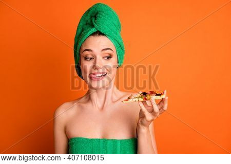 Photo Portrait Of Woman Holding In One Hand Looking At Pizza Slice Licking Lips Isolated On Vivid Or