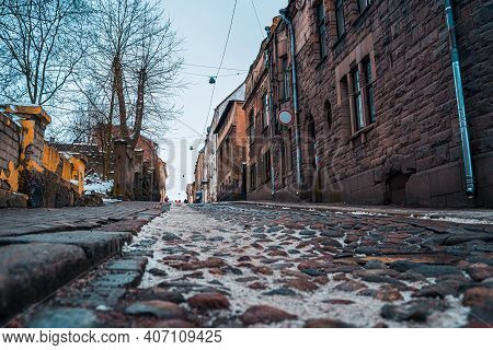 Cobblestone Pavement. Street Of The Old City Center In Vyborg. Winter View.