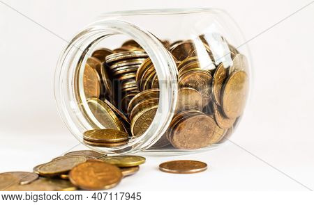 Metal Russian Coins Lie In A Glass Jar Isolated On A Light Background. Store And Protect Savings. Lo