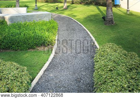 Walkway And Bush In Garden. Constructed From Asphalt Concrete. Also Called Path, Footpath, Passage O
