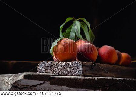 Still Life Peaches On Wooden Table Cutting Board Knife Dark Mood. Juicy Ripe Peaches On Dark Wooden