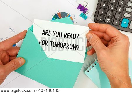 The Businessman Takes Out A Card From The Envelope With The Text Are You Ready For Tomorrow, On The