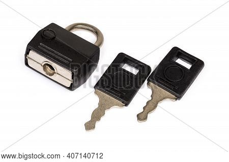 Locked Small Traditional Detachable Luggage Lock With Two Keys On A White Background