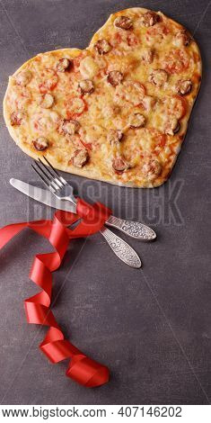 Valentine's Day Romantic Dinner. Pepperoni Pizza, Cutlery And Bright Scarlet Ribbon On Dark Table