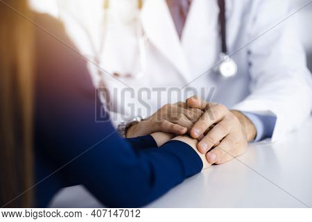 Unknown Man-doctor Reassuring His Female Patient, Close-up. Perfect Medical Service, Empathy In Medi