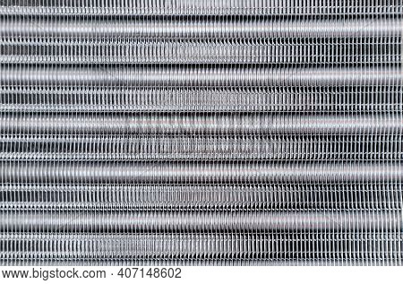 Part Of Cooling Radiator As Background. Top View. Bank Of Cells And Aluminum Tubes In Which Circulat