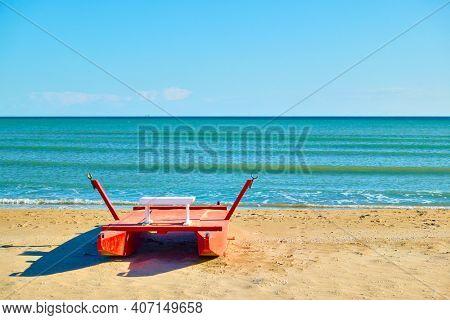 Beach in Rimini with rescue boat by the sea, Italy. Italian resort, landscape