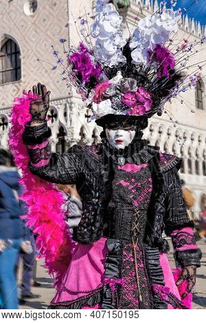 Colorful Carnival Masks At A Traditional Festival Against Doge Palace In Venice, Italy