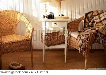 Cozy Skandinavian Interior Home With Wicker Rattan Armchairs In Living Room. Rattan Chair And Wooden