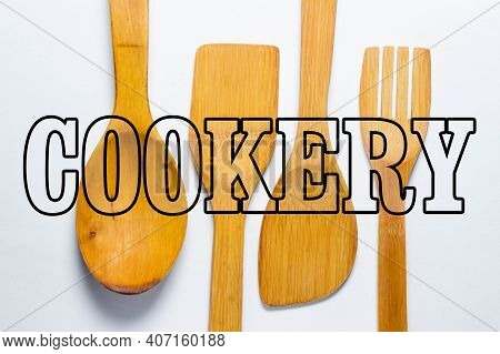 Cookery. Wooden Kitchen Utensils On A White Background, From Above The Inscription \