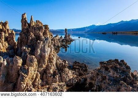 California, USA. Picturesque lake with lime-tuff towers of fancy shape. Dusk. Mono Lake is a natural wonder of the world. The concept of ecological, exotic and photo tourism