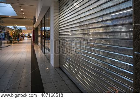 Luebeck, Germany, January 25, 2021: Closed Stores In The Hallway Of A Shopping Center During The Loc