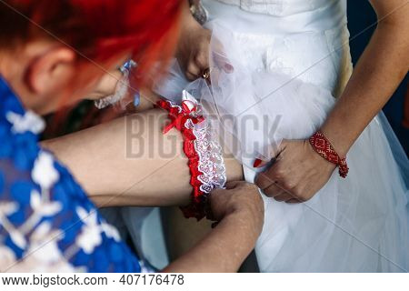 Bride's Garter On The Leg. Stocking Of The Bride. Wedding Preparation