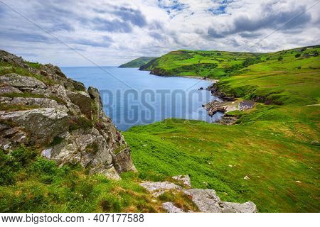 View from Torr Head on the Causeway Coastal route and on small harbour and salmon fishery of Portaleen, Ballycastle, County Antrim, Northern Ireland, United Kingdom