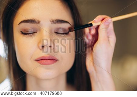 Portrait Of A Beautiful Face Of A Woman With Closed Eyes And Beautiful Makeup. The Makeup Artist App