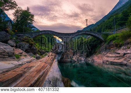 Double Arch Stone Bridge At Ponte Dei Salti In Lavertezzo, Canton Tessin, Switzerland, With The Clea
