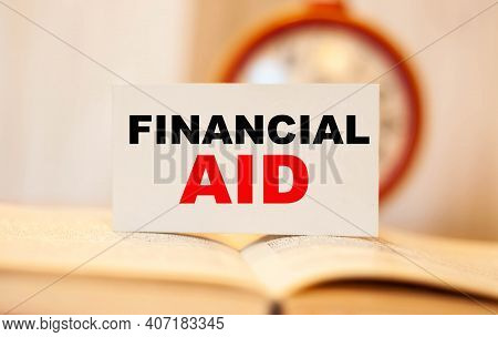 Financial Aid On An Open Folder With A Round Clock In The Background