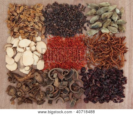 Traditional chinese herbal medicine selection over papyrus background. poster