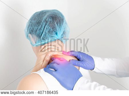 The Doctor Conducts A Medical Examination Of A Female Patient Of The Cervical Spine. Headache From C