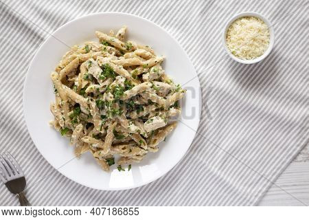 Homemade Chicken Alfredo Penne With Parsley On Cloth, Top View. Overhead, From Above, Flat Lay.
