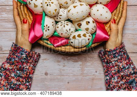 Happy Easter. Woman Hands Holding Basket With Hand Made Decorated Easter Eggs.spring Decoration Back