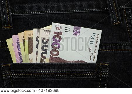 Money In Your Pocket. Ukrainian Hryvnia. 1000, 500, 200 Bills In A Pants Pocket. Jeans Trousers, A L