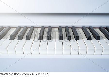 Piano Keyboard. Classical Music On Electronic Digital Piano. Beautiful White Piano Keys Close Up.