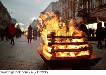 Bonfires Lit On Gediminas Avenue On The Night On February 16 In Vilnius, Lithuania. People Attending