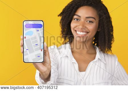 Happy African American Lady Showing Mobile Phone With Gps Navigation App Recommending Application Po