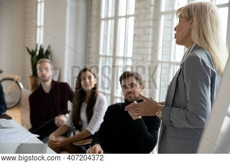 Female Business Leader Giving Workshop To Employees