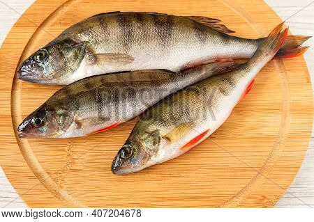 Fresh Roach Fish For Cooking Lies On A Cutting Wooden Board.