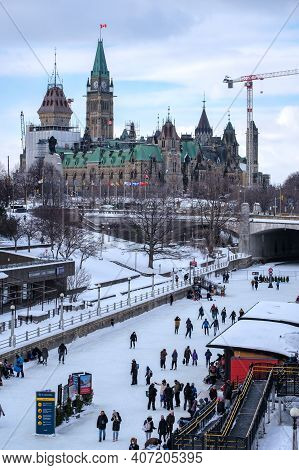 Ottawa, Ontario, Canada - February 6, 2021: A Wintertime View Of Parliament Hill And The Frozen Ride