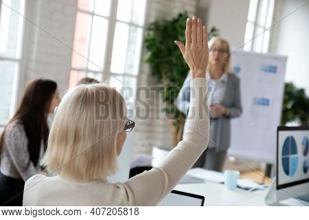 Intern Asking Question To Corporate Coach At Workshop