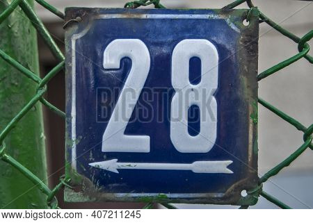 Weathered Grunge Square Metal Enamelled Plate Of Number Of Street Address With Number 28
