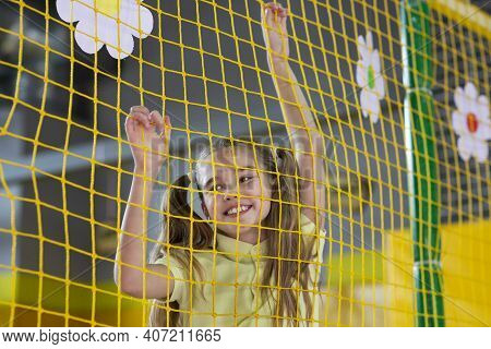 Portrait Of Cute Teen Girl Playing Inside Indoor Kids Labyrinth, Having Fun At Amusement Centre. Ado