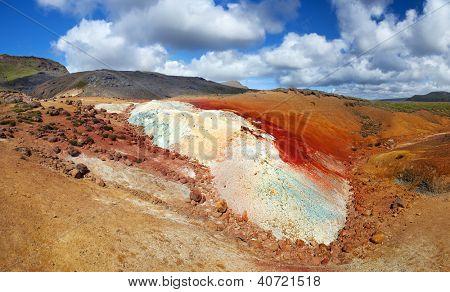 Extremely vivid multicolored land at geaothermal area Seltun near Krysuvik, Reykjanes peninsula - Iceland. Panoramic photo