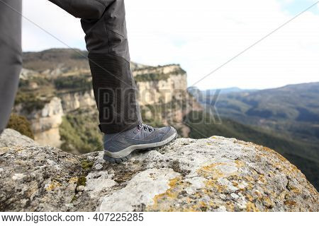 Close Up Of A Trekker Boot In The Top Of A Cliff In The Mountain