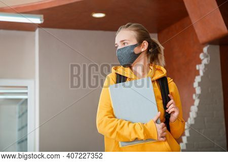 Young Beautiful Woman Student Wearing Protective Mask With Backpack. Teen Girl Blonde Caucasian Teen