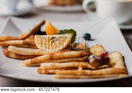 Plate Of Pancakes Nuts And Blueberries, Oranges Pieces. Shrovetide Maslenitsa Butter Week Festival M