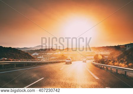 Movement Of Vehicles On Freeway, Motorway E-15 Near Malaga In Spain. Sunset Time