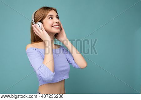 Side-profile Photo Of Beautiful Positive Smiling Young Blonde Woman Wearing Blue Crop Top Isolated O