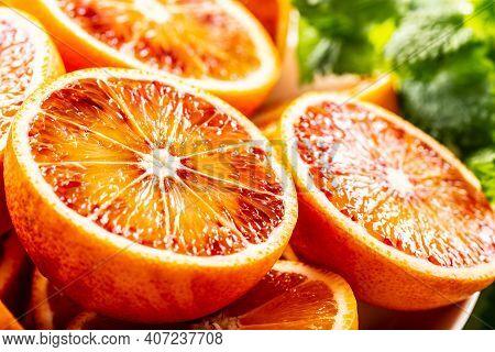 Blood Sicilian Oranges Sliced With Fresh Melissa - Close Up