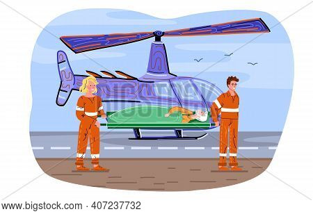 Male And Female Medic Rescuers Transporting Male Patient To Helicopter For Emergency Delivery To Hos