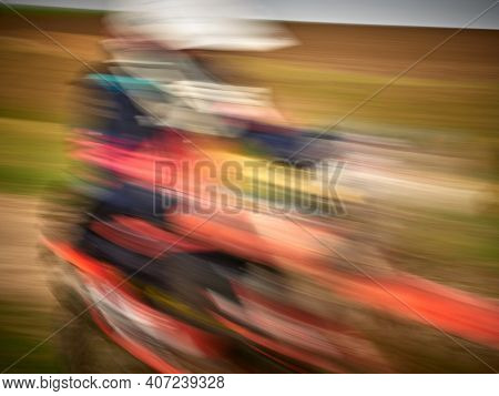 dinamic image of motocross bike racer competing, speed and power in extreme man sport , sport action concept