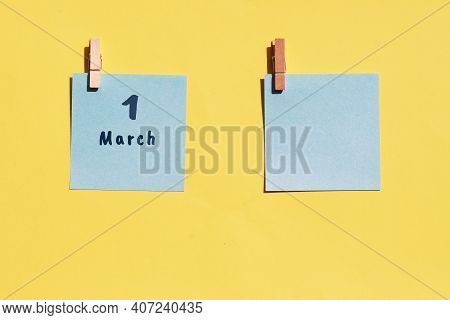 March 1st. Day Of 1 Month, Calendar Date. Two Blue Sheets For Writing On A Yellow Background. Top Vi