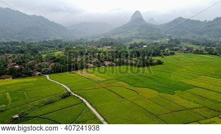 Aerial View Of Rice Fields On Terraced Of Cariu With Noise Cloud After Rain, Bogor, Indonesia. Indon